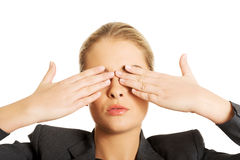 Woman covering her face with both hands Stock Photography
