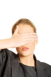 Woman covering her face with both hands Royalty Free Stock Photos