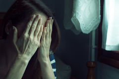 Woman covering her face. Stock Image