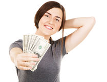 Woman covering her face with dollar bills Stock Photos