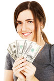 Woman covering her face with dollar bills Stock Photo