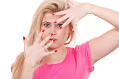Woman covering her face with hands Stock Image