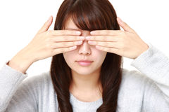 Woman covering her face with hands Royalty Free Stock Images