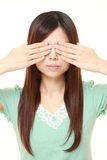 Woman covering her face with hands Stock Photography