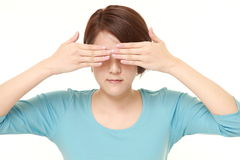 Woman covering her face with hands Stock Images