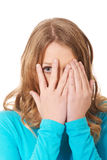Woman covering her face with hands Royalty Free Stock Photography