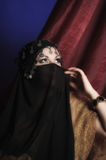 Woman covering her face Stock Image