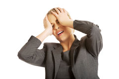 Woman covering her face to camouflage Royalty Free Stock Image