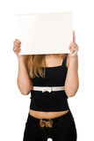 Woman covering her face with white board Stock Images