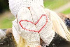 Woman covering her face with winter gloves Royalty Free Stock Photo