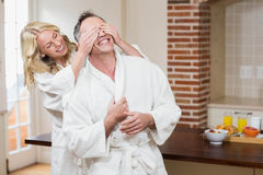 Woman covering her husband eyes Royalty Free Stock Photo