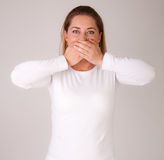 Woman covering her mouth Royalty Free Stock Images