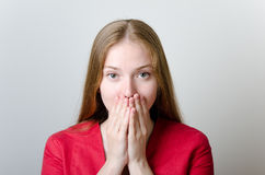 Woman covering her mouth Stock Photography