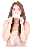 Woman Covering Her Mouth With Blank card Stock Photography