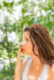Woman covering her mouth Stock Images