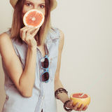 Woman covering her mouth with grapefruit. Fun summer Stock Photography