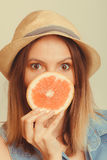 Woman covering her mouth with grapefruit. Fun summer Royalty Free Stock Photos