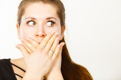 Woman covering her mouth with hand. Seeing something shocking, surprised and speechless face expression Royalty Free Stock Photos