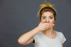 Woman covering her mouth with hand. Seeing something shocking, surprised and speechless face expression Royalty Free Stock Images