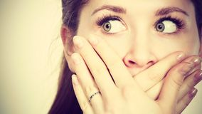 Woman covering her mouth with hand. Seeing something shocking, surprised and speechless face expression Royalty Free Stock Photo