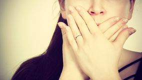 Woman covering her mouth with hand. Seeing something shocking, surprised and speechless face expression Stock Image