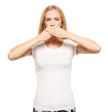 Woman covering her mouth with her hands Royalty Free Stock Photos