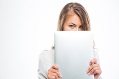 Woman covering her mouth with laptop Royalty Free Stock Image