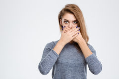 Woman covering her mouth with palms Stock Photo