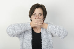 Woman is covering her mouth. Stock Photos