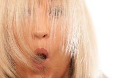 Woman covering her surprised face with long straight hair. Royalty Free Stock Image