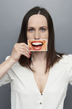 Woman covering image with big smile Stock Image