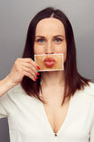Woman covering with lips picture stock image