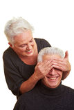 Woman covering man's eyes Royalty Free Stock Photos