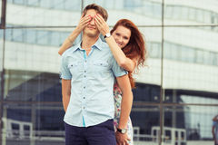 Woman covering man's eyes hands Royalty Free Stock Images