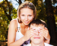 Woman covering mans eyes Stock Photography