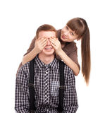 Woman covering mans eyes Royalty Free Stock Photos