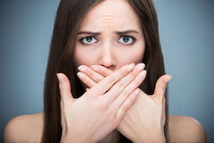 Woman covering mouth Stock Photo