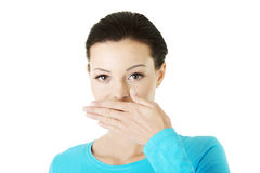 Woman covering mouth with hand. Isolated Stock Image