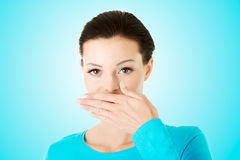 Woman covering mouth Royalty Free Stock Photo
