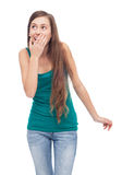 Woman covering mouth and looking up Stock Photo