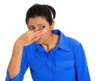 Woman covering nose Stock Photos