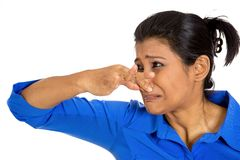 Woman covering nose Royalty Free Stock Photo