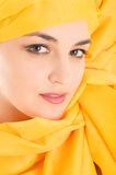 Woman covering with yellow cloth Stock Photography