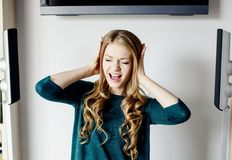Woman covers her ears Stock Photography