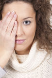 Woman covers her eye Stock Photography
