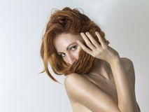 Woman covers her face with her red hair Royalty Free Stock Photo