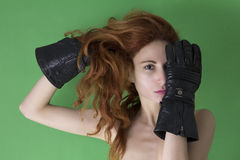 Woman covers her face with one hand with black glove Royalty Free Stock Photography