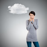 Woman covers her mouth with hand. Grey background with cloud Royalty Free Stock Photo