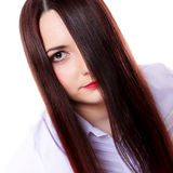 Woman covers part of face by straight long hair Stock Photo