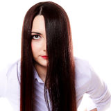 Woman covers part of face by straight long hair Stock Photography